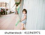 happy girl standing in front of ... | Shutterstock . vector #411965971