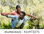 happy family having fun at park | Shutterstock . vector #411972271
