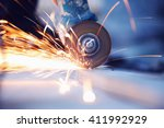 metal sawing with sparkles... | Shutterstock . vector #411992929