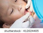 young asian girl during dental... | Shutterstock . vector #412024405