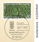 Small photo of ST. PETERSBURG, RUSSIA - APR 27, 2016: A first day of issue postmark printed in Germany, shows Rice field, German Agro Action Organization, 125th Anniv., circa 1987