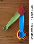 A Blue Measuring Spoon With Th...