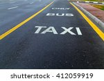 bus and taxi sign painted on... | Shutterstock . vector #412059919