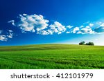 green field and beautiful sunset | Shutterstock . vector #412101979