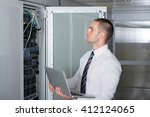 young it consultant working in... | Shutterstock . vector #412124065