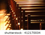 rows of church benches.... | Shutterstock . vector #412170034