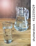 a glass and a carafe of the... | Shutterstock . vector #412255429