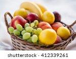 fruit basket on a white... | Shutterstock . vector #412339261