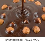 chocolate flows on nuts. tasty... | Shutterstock . vector #41237977