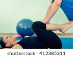physical therapist working with ... | Shutterstock . vector #412385311