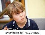 eating boy is looking...   Shutterstock . vector #41239801