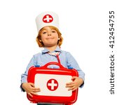 young boy with medical cap and... | Shutterstock . vector #412454755