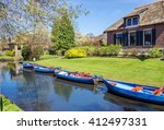 boats in canal in giethoorn  a... | Shutterstock . vector #412497331