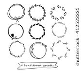 set of 9 hand drawn wreaths.... | Shutterstock .eps vector #412523335
