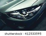 headlight of a modern luxury... | Shutterstock . vector #412533595