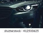 headlight of a modern luxury... | Shutterstock . vector #412533625
