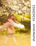 little girl dancing in the... | Shutterstock . vector #412620421