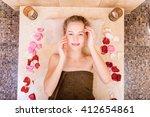happy woman in hammam or... | Shutterstock . vector #412654861
