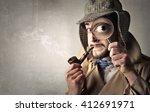 retro dressed detective | Shutterstock . vector #412691971