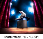 Stock photo photo composite of a bunny in a magic hat on a stage 412718734