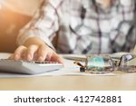 hand of accountant analyzing... | Shutterstock . vector #412742881