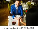 man and woman in a restaurant... | Shutterstock . vector #412744231