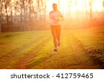 fitness woman running on the... | Shutterstock . vector #412759465