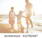 family playing on the beach. | Shutterstock . vector #412782367