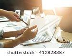 2 yung business startup man... | Shutterstock . vector #412828387