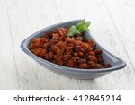 raisin in the bowl on the wood... | Shutterstock . vector #412845214