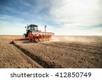 farmer seeding crops at field | Shutterstock . vector #412850749