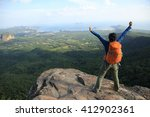 cheering successful woman hiker ...   Shutterstock . vector #412902361