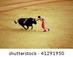 "SEVILLE - APRIL 30:  Bullfighter David Fandila ""El Fandi"" fights for a sold out crowd at the Plaza de Toros de Sevilla on April 30, 2009 in Seville, Spain. - stock photo"