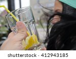 girl drinking water  | Shutterstock . vector #412943185