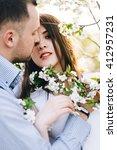 couple walks in the lush garden.... | Shutterstock . vector #412957231