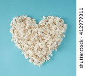 Heart made of white flowers. Flat lay. Love concept.