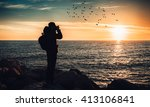 man photographer ahead to a... | Shutterstock . vector #413106841