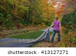 a woman picks up the road and... | Shutterstock . vector #413127271
