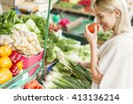 young woman baying vegetable on ... | Shutterstock . vector #413136214
