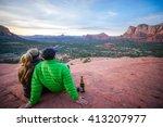 Couple Watching A Desert Sunset ...