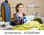 young beautiful female tailor... | Shutterstock . vector #413209264