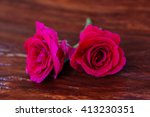 red rose on wooden background | Shutterstock . vector #413230351