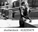 sad woman holding bunch of...   Shutterstock . vector #413255479