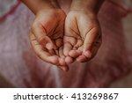 Stock photo open children hand begging for help 413269867
