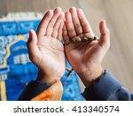 Hands Of Muslim Child Praying...