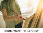 cropped shot of artist makes... | Shutterstock . vector #413370259