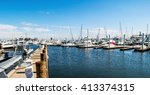 A Panoramic View Of A Marina...