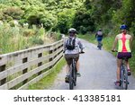 family mountain bike cycling | Shutterstock . vector #413385181