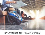 backpack and hat at the train... | Shutterstock . vector #413464489