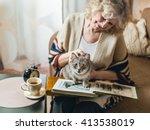 An Elderly Woman Watching Phot...